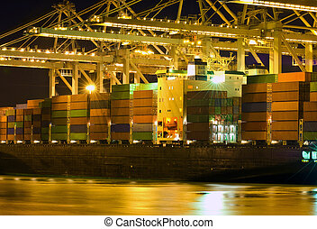 Unloading of a bulk carrier - Close up of a container ship...