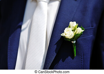 boutonniere flower on jacket of wedding groom - boutonniere...