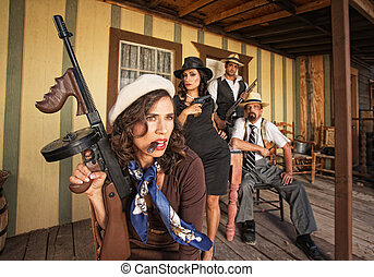 Tough Smoking Woman with Submachine Gun - Tough gangster...