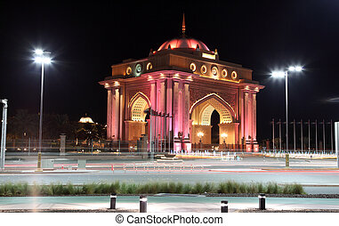 Emirates Palace gate illuminated at night. Abu Dhabi, United...