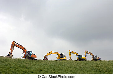 Four diggers on a dyke in Zeeland, the Netherlands
