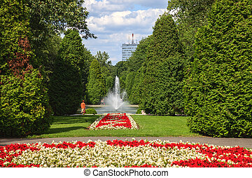 City park in Balystok - Fountain in city park with flowers...