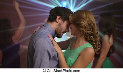 Clubbing Couple - Tilt of a sensual clubbing couple