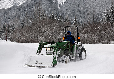 Snow cleaning. - Tractor cleans a runway from snow. Alaska