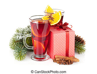 Christmas mulled wine with spices, gift box and snowy fir...