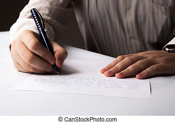 man is writting on a sheet of paper - man is writting by pen...