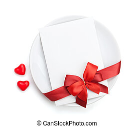 Valentines Day love letter over plate with red bow Isolated...