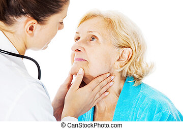 Doctor Examining Senior Womans Throat - Young female doctor...