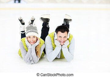 We love ice skating - A picture of a young coupleresting on...