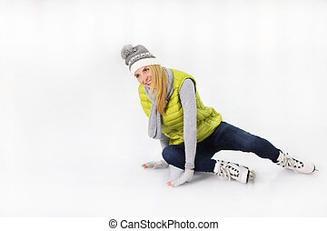 Ice fall - A picture of a young woman falling on an ice rink