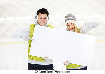 Skate with us! - A picture of a young couple showing a white...