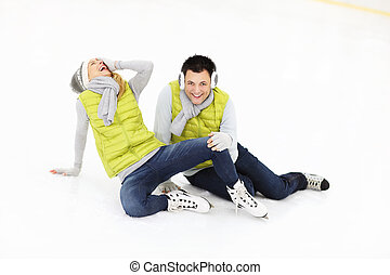 Falling on ice - A picture of a young couple ice-skating on...