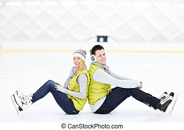 Ice couple - A picture of a young couple resting on an ice...
