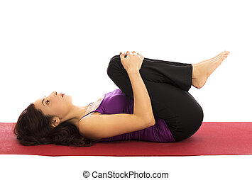 Yoga relaxation Pose - Young woman relaxing during yoga