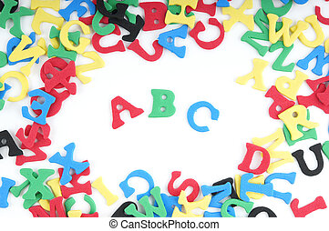 ABC spelled out with colorful songe rubber letters