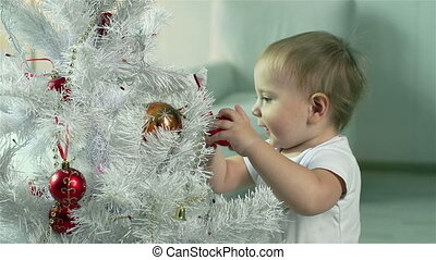 Curious Baubles - Lad being curious about colorful baubles...