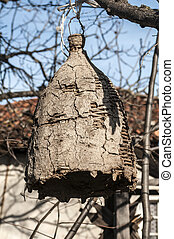 Old beehive for wild bees - Old hanging beehive made of...