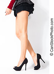 high heel shoes - woman legs in black high heel shoes and...