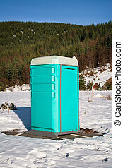 Porta Potty in the Snow - Portable bathroom in a snow filled...