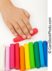 Child hand with modeling clay - Child hand with colorful...