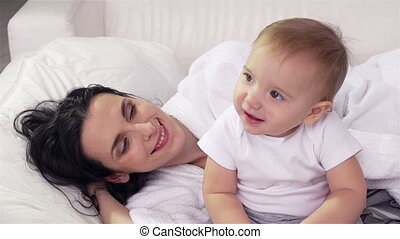 Awake - Mother and child waking up after a sweet sleep