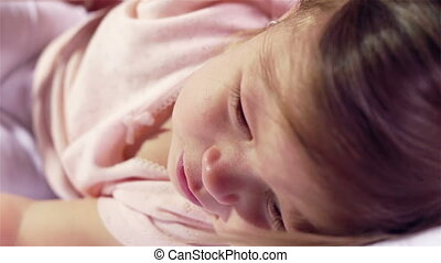 Beautiful Baby - Close-up of a beautiful baby making herself...