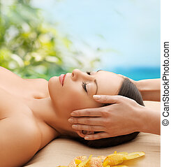 beautiful woman in massage salon - spa, resort and beauty...