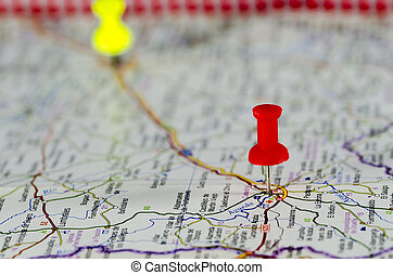 Travel Destination - Red pushpin marking a location on a...