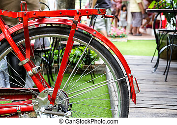 Red bicycle equipped with a large basket