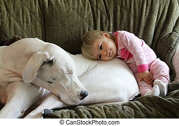 Great Dane and baby snuggle on couch