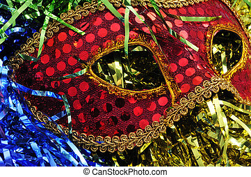 carnival mask - a red and golden carnival mask on a...