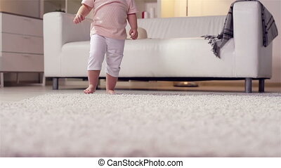 Little Feet - Little kid making a step after step across the...