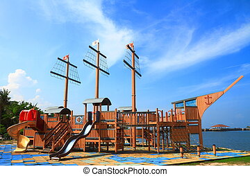 Pirate ship in playground with blue sky