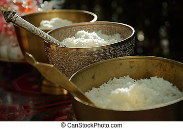 Cooked rice in brass bowl ,The merit of Thais in wedding