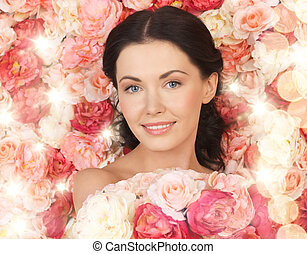 woman with background full of roses - bridal and beauty...