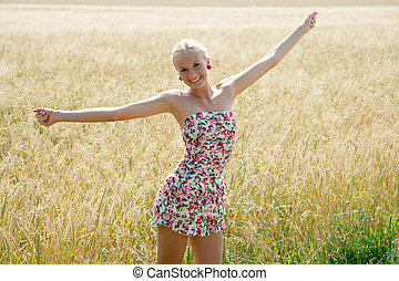 young blonde woman in nature - Young woman in summer dress...