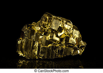 pyrite mineral stone in front of black