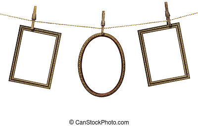 three picture frame hanging on clothespins isolated on white...
