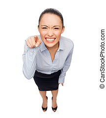 angry businesswoman pointing finger at you - business and...