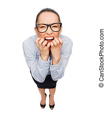 frightened businesswoman biting her fingers - business and...