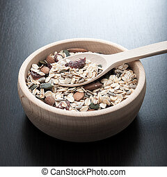 Delicious and healthy cereal in wooden bowl