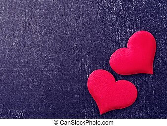 two red hearts on a black board - valentine card. two red...