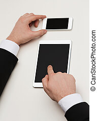 businessman working with tablet pc and smartphone