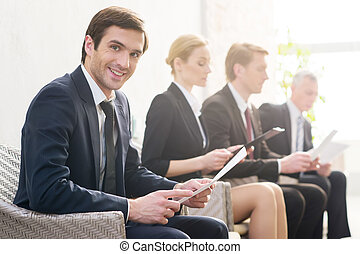 I will get this job! Four people in formalwear waiting in...