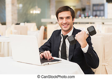Sports and business Smiling young man in formalwear sitting...