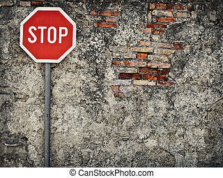 no way through - stop sign against grungy wall, may...