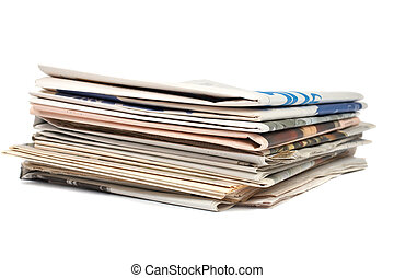 Stack of local newspapers - A stack of local newspapers with...