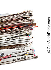 Local newspapers - A stack of local newspapers with focus on...