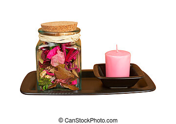 Candle and essence jar - The candle and essence jar isolated...