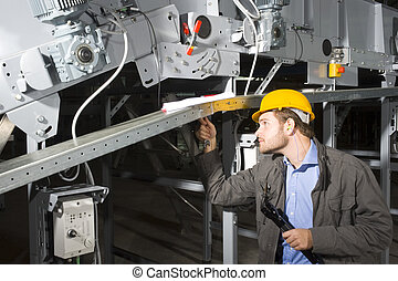 Maintenance engineer at work - A maintenance engineer at...